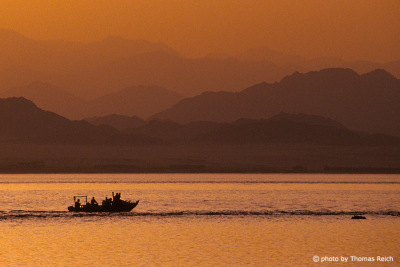 Silhouette Bedouin fishing boat in the Red Sea, Egypt