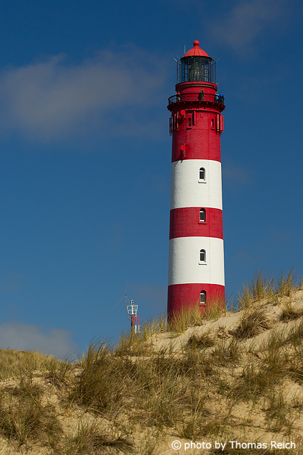 Red white lighthouse Amum