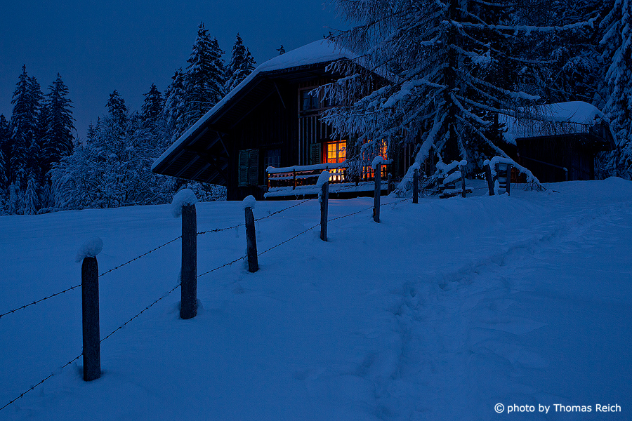Mountain hut in winter Bernese Oberland