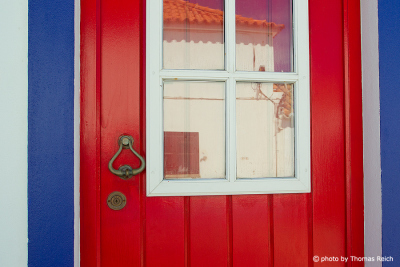 Red door in Porto Covo, Alentejo, Portugal