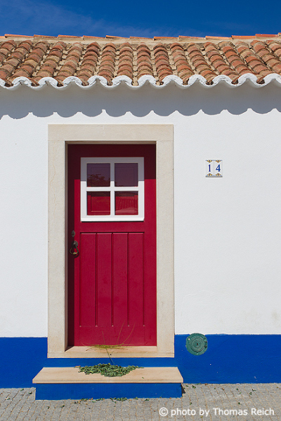 Red door in Porto Covo, Alentejo